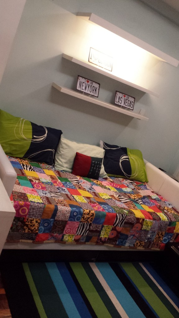 Our sleeping area uses a day bed with a nice handmade quilt.