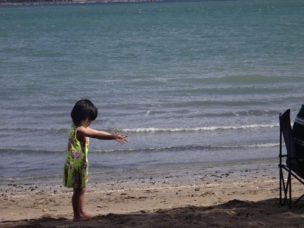 The little girl enjoying a day at the beach in Devonport