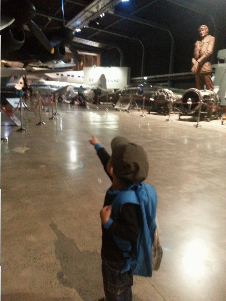 Excited little boy inside MOTAT's Aviation Display Hall