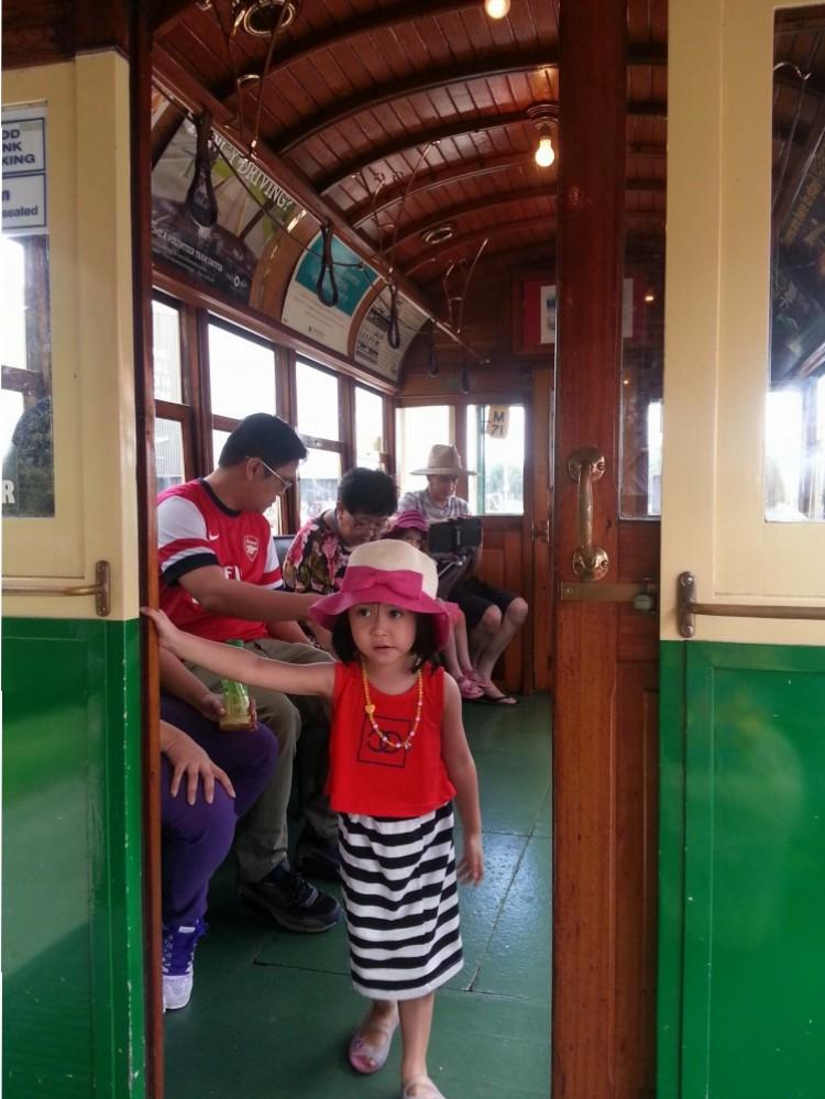 The little miss inside the tram.