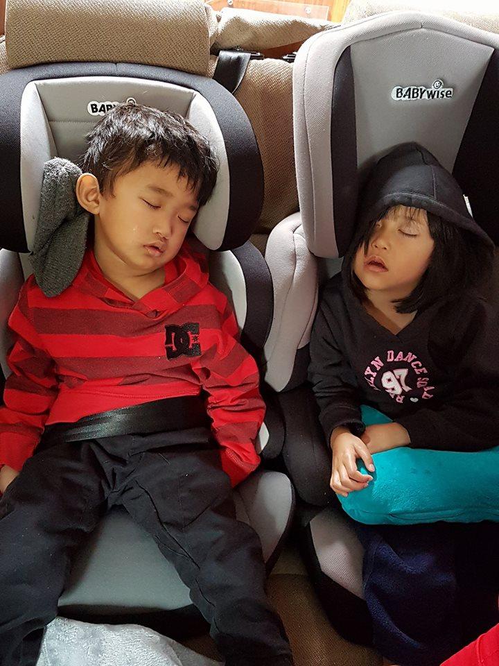 Kids asleep in a motorhome